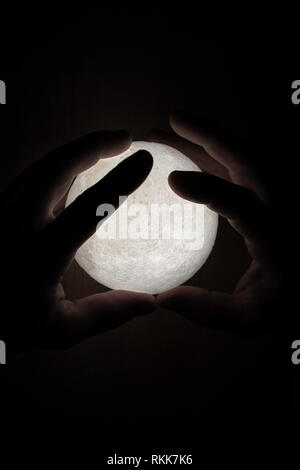 Small moon light in mans hands