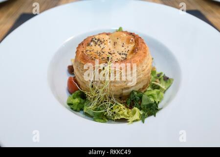 Salmorejo with tuna tartare, pansy flower and salad vinaigrette with soya sauce and salvia. - Stock Photo