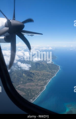Window seat view from a 'puddle jumper' plane on an island hopping trip in  Visayas, Philippines - Stock Photo
