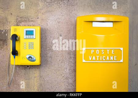 Detail of the traditional yellow post box in Vatican City, Rome. - Stock Photo