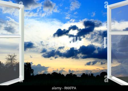 Window opened to sunset with dark clouds. Evening coolness. Opened white window with view of dark clouds. - Stock Photo