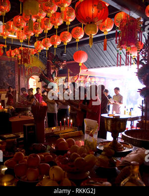 Prior to Chinese New Year date, a group of Bhuddist people are praying in a Vihara (Buddhist place for worshipping). - Stock Photo