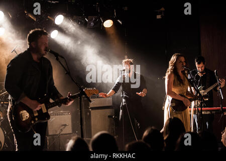 The American band The Lone Bellow performs a live concert at VEGA in Copenhagen. Here singer and musician Zach Williams (C) is seen live on stage. Denmark, 05/02 2016. EXCLUDING DENMARK. - Stock Photo