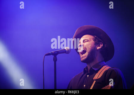 The American band The Lone Bellow performs a live concert at the Danish music festival Jelling Festival 2016. Here singer and musician Zach Williams is seen live on stage. Denmark, 28/05 2016. EXCLUDING DENMARK. - Stock Photo
