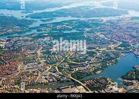 Aerial shot over Solna Lidingo Sweden during inflight to Arlanda airport on a sunny day in June in Stockholm, Sweden. - Stock Photo