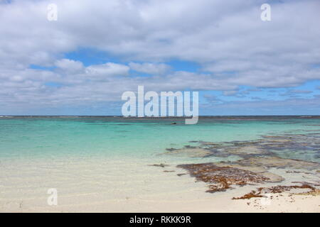 Beautiful calm open sea with blue cloudy sky on the coast of Rottnest Island, Western Australia - Stock Photo