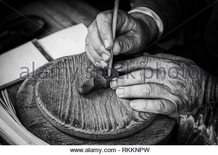 Potter working clay, detail person working, manual labor. Spain. - Stock Photo