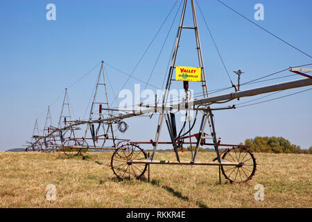 Antique 'Valley Self-Propelled' Wheel Line Pivot irrigation system,  dormant irrigated pasture. - Stock Photo