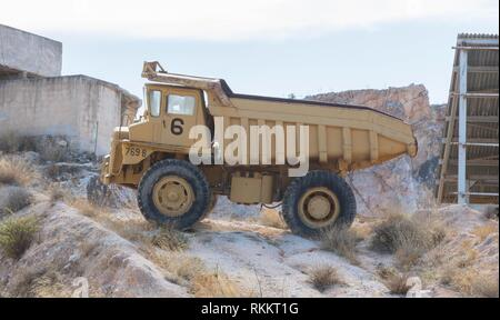 Old industrial truck for stone waiting on a site in Greece. - Stock Photo