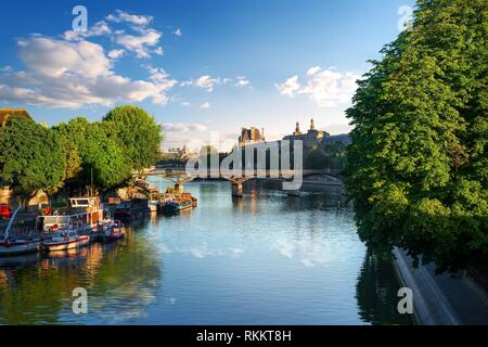 View on Pont des Arts in Paris at summer sunrise. - Stock Photo