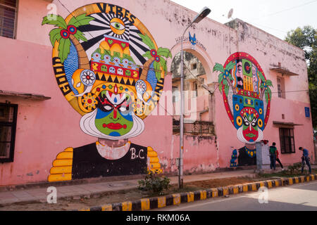 Group of young men filming in front of large street mural by Indian artist Harsh Raman, in Lodhi Colony, New Delhi, India - Stock Photo