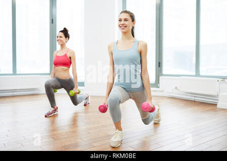 Two Women Training in Gym - Stock Photo