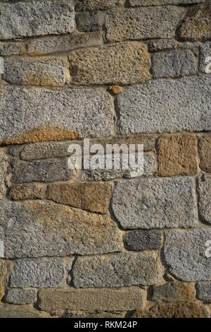Granite stone bush hammered masonry wall in Galicia Spain. - Stock Photo