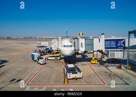 NEW YORK - MARCH 22, 2016: passenger jet airplane docked at JFK Airport. John F. Kennedy International Airport is a major international airport locate - Stock Photo