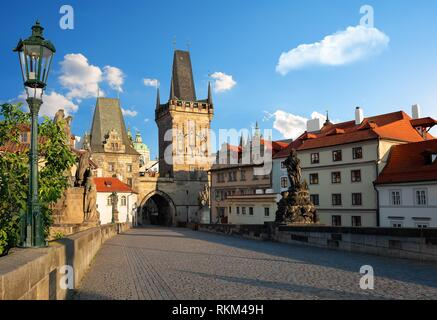 Early morning on Charles Bridge in Prague at summer. - Stock Photo