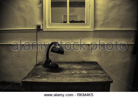 Old lamp on table, studio table detail. - Stock Photo