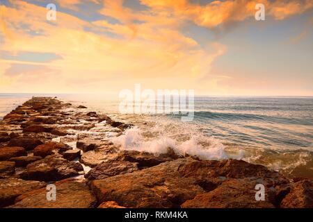 Burriana breakwater in Castellon of Mediterranean Spain. - Stock Photo