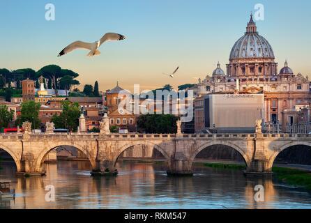 Birds flying over Tiber river near Vatican and bridge of Vittorio Emanuele II, Italy. - Stock Photo