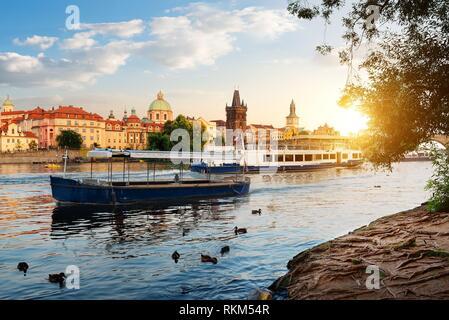 Boats on Vltava river near the Charles bridge in Prague. - Stock Photo