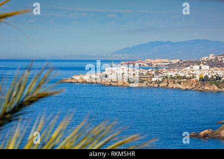 Nerja, Costa del Sol, Malaga Province, Andalusia, southern Spain. View from near Maro to Nerja with the lighthouse of Torrox Costa visible behind. - Stock Photo