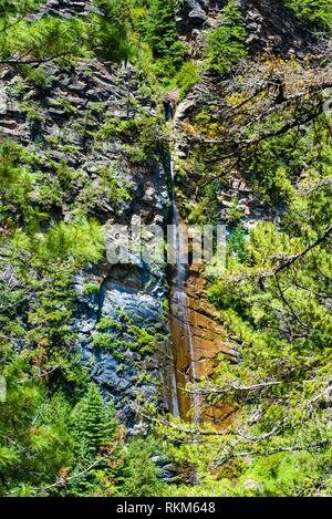 Nature view with waterfall in Annapurna Conservation Area, a hotspot destination for mountaineers and Nepal's largest protected area. - Stock Photo