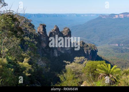 View over Jamison Valley and Three Sisters rock formation from Echo Point lookout in Katoomba, Blue Mountains, New South Wales, Australia. - Stock Photo