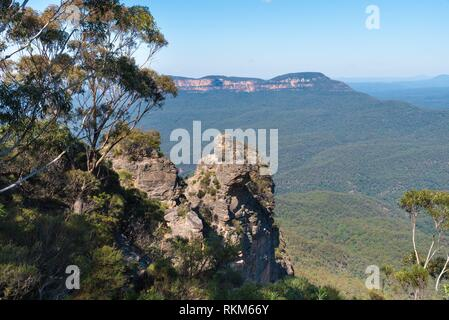 View over Jamison Valley and Three Sisters rock formation in Katoomba, Blue Mountains, New South Wales, Australia. - Stock Photo