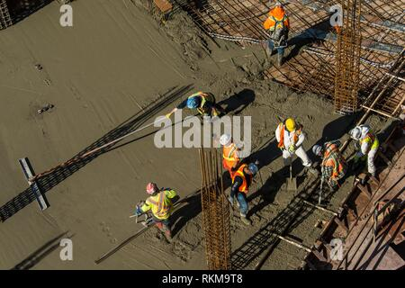 Construction workers at Vancouver House, a tower under construction in Vancouver, BC, Canada. - Stock Photo