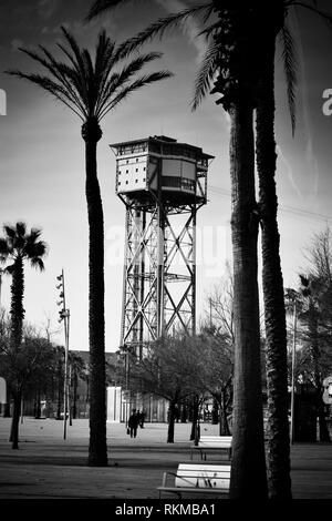 Cable car tower near Barceloneta beach and Port Vell. Designed by Carles Buigas. Built in 1929 for the Universal Exhibition celebrated in Barcelona. - Stock Photo