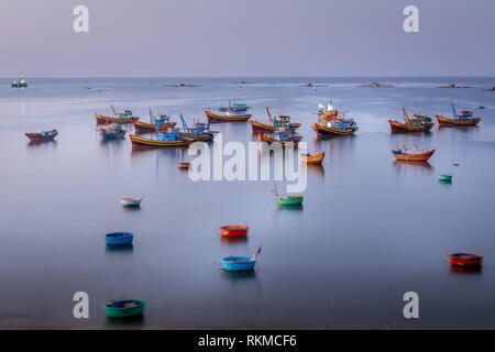 traditional Vietnamese boats on the sea in Mui Ne, Vietnam - Stock Photo