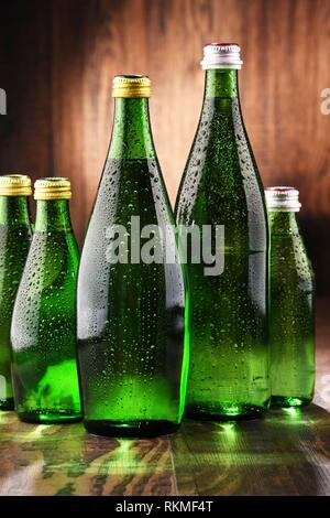 Composition with glass bottles of mineral water. - Stock Photo