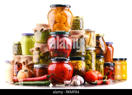 Jars with variety of pickled vegetables isolated on white. Preserved food. - Stock Photo