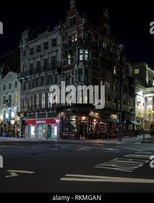 Night streets in London. Strand street exit to Waterloo Bridge. - Stock Photo
