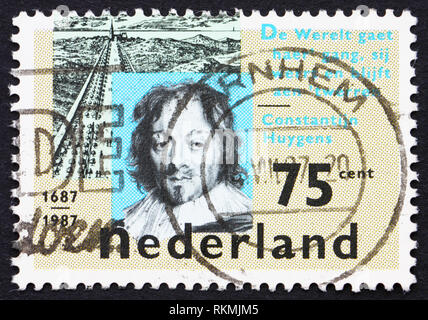 NETHERLANDS - CIRCA 1989: a stamp printed in the Netherlands shows Constantijn Huygens and Scheveningseweg, The Hague, circa 1989 - Stock Photo