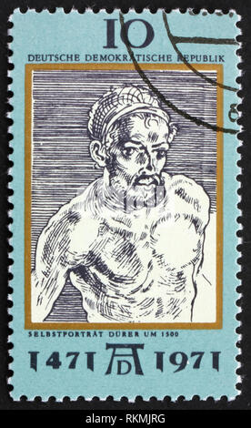 DDR - CIRCA 1971: a stamp printed in DDR shows Self-Portrait, by Durer, 500th anniversary of the birth of Albrecht Durer, painter and engraver, circa  - Stock Photo