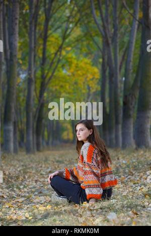 Portrait of a teen girl in autumn forest. - Stock Photo