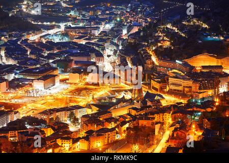 Andorra la Vella skyline at sunset in Pyrenees mountains. - Stock Photo