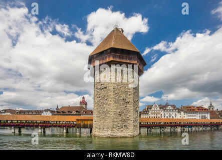 the wooden medieval Kapellbrücke (Chapel Bridge) with its iconic octagonal stone tower, Wasserturm, meaning tower in the water, Lucerne, Canton Lucern - Stock Photo