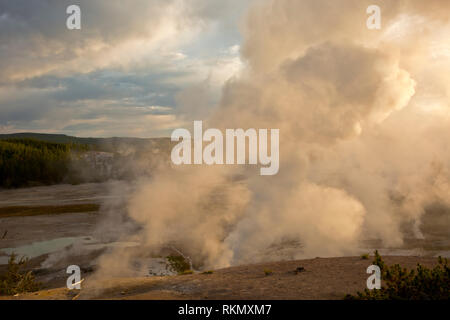 WY03426-00...WYOMING - Steam rising from fumerals at Porcelain Basin in the cool early morning air as the sun comes up over the Norris Geyser Basin i - Stock Photo