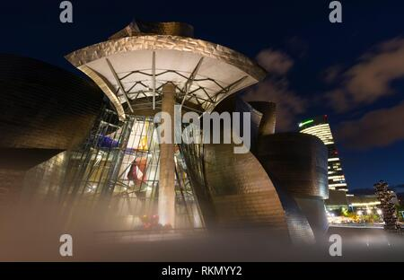 Guggenheim Museum Bilbao. Museum of modern and contemporary art designed by Canadian-American architect Frank Gehry. Nervion river, Bilbao, Bizkaia, - Stock Photo