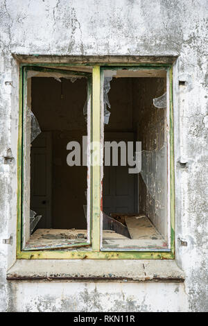 Opened window glass broken to an abandon building - Stock Photo