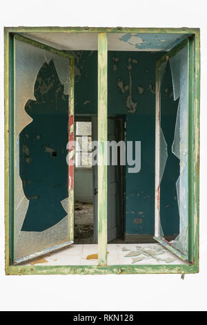 Opened window glass broken to an abandon building isolated on white - Stock Photo