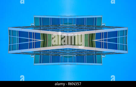 Abstract angular building in Provo Utah grid. Geometric kaleidoscope pattern on mirrored axis of symmetry reflection. Colorful shapes as a wallpaper f - Stock Photo