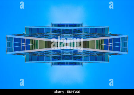 Abstract angular building in Provo Utah rectangle. Geometric kaleidoscope pattern on mirrored axis of symmetry reflection. Colorful shapes as a wallpa - Stock Photo