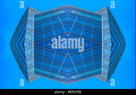Abstract blue glass building in downtown grid. Geometric kaleidoscope pattern on mirrored axis of symmetry reflection. Colorful shapes as a wallpaper  - Stock Photo