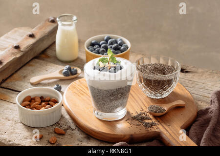 Chia pudding with berries and milk, sweet nourishing dessert, healthy breakfast superfood concept - Stock Photo
