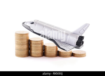Space shuttle with rising coins isolated on white background - Stock Photo