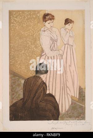 The Fitting - 1890–91 - Mary Cassatt (American, 1844-1926) printed with Leroy (French, active 1876-1900) - Artist: Mary Cassatt, Origin: United - Stock Photo