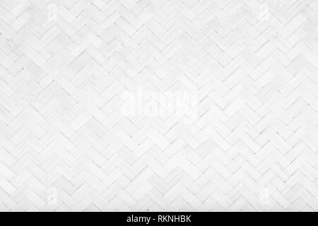 White Mat Traditional handicraft bamboo weave texture background. Wicker surface pattern material for wall with antique cracking furniture painted wea - Stock Photo