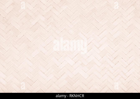Brown Mat Traditional handicraft bamboo weave texture background. Wicker surface pattern material for wall with antique cracking furniture painted wea - Stock Photo